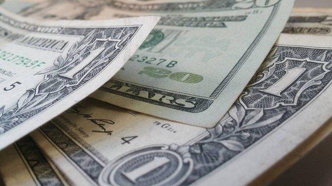 Cédulas de dólar, a moeda oficial dos Estados Unidos . Crédito: Pixabay