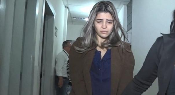 A pastora Juliana Salles, quando foi detida em Minas Gerais em cumprimento a mandado de prisão temporária. Crédito: TV Leste | Record MG | Arquivo
