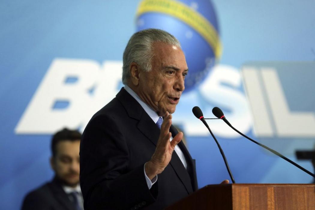 O presidente Michel Temer discursa na cerimônia de sanção da lei que cria o Sistema Único de Segurança (SUSP), no Palácio do Planalto. Crédito: Valter Campanato/Agência Brasil