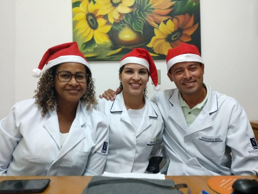 Técnica de enfermagem, enfermeira e assistente social que também fazem parte do projeto. Crédito: Mariana Martinez